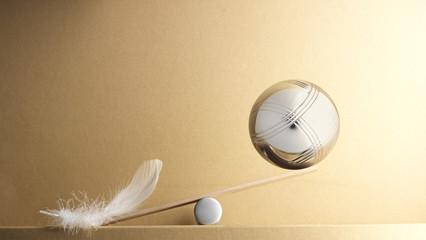 balance de plume contre boule de pétanque