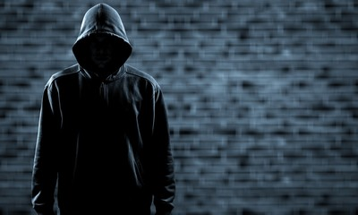 Thief in black clothes on grey background Wall mural
