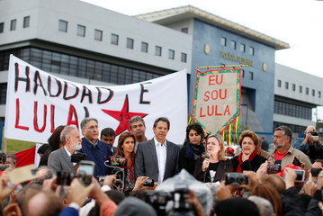 Workers Party Presidential candidate Fernando Haddad, stands as Senator Gleisi Hoffmann speaks in front of the Federal Police headquarters, where former Brazilian President Luiz Inacio Lula da Silva is imprisoned, in Curitiba