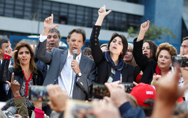 Workers Party Presidential candidate Fernando Haddad, gestures with his wife Ana Estela in front of the Federal Police headquarters, where former Brazilian President Luiz Inacio Lula da Silva is imprisoned, in Curitiba