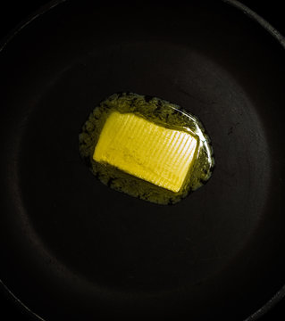 Melting butter/margarine in a heated pan