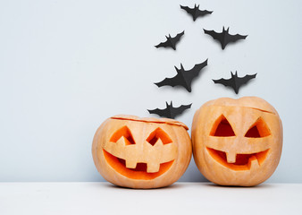Halloween craft background with pumpkins and flying bats.