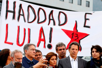 Workers Party Presidential candidate Haddad, stands next to his vice presidential candidate d'Avila in front of the Federal Police headquarters, where Brazilian former President Luiz Inacio Lula da Silva is imprisoned, in Curitiba