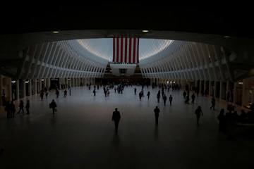 An American flag hangs inside the Oculus transportation hub at the World Trade Center in lower Manhattan on the 17th anniversary of the September 11, 2001 attacks in New York