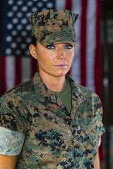 A United States Female Marine Posing In A Military Uniform