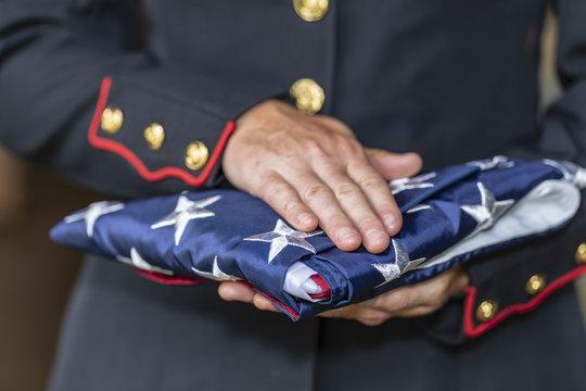A United States Female Marine Posing In A Military Uniform