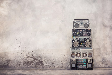 Retro old school design ghetto blaster boombox  stereo radio cassette tape recorders tower from circa 1980s front concrete wall background. Vintage style filtered photo Wall mural