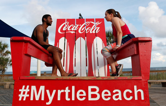 Dameek Deaver and Anastasiia Lugova, both of Myrtle Beach, relax on a large beach chair before they leave the coast ahead of the arrival of Hurricane Florence in Myrtle Beach