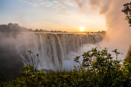 Victoria Falls at sunrise. Observing the power of the water falls.