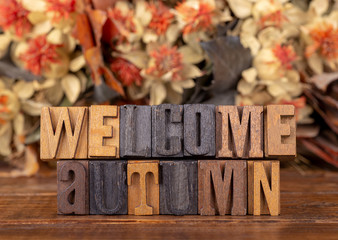 Welcome Autumn Block Lettering With Fall Background