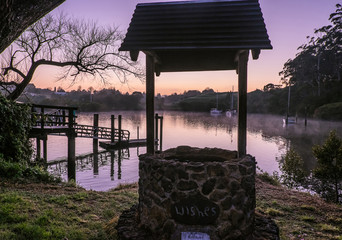 Wishing well overlooking Kerikeri Inlet with morning mist over water. Photographed at dawn at Kororipo Pa, Far North District, Northland, New Zealand, NZ