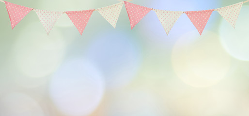 Colorful party flags hanging on blur abstract background, birthday, anniversary, celebrate event, festival greeting card background