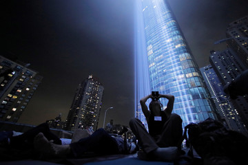 Members of the New York City Audubon Society monitor birds attracted to the Tribute in Light installation as it is illuminated over lower Manhattan marking the 17th anniversary of the 9/11 attacks in New York