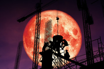 super blood moon back silhouette worker on construction night sky