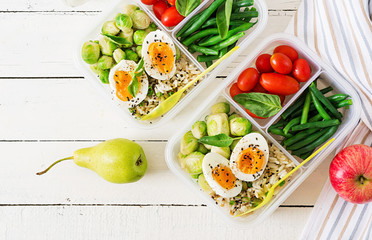 Foto op Plexiglas Assortiment Vegetarian meal prep containers with eggs, brussel sprouts, green beans and tomato. Dinner in lunch box. Top view. Flat lay