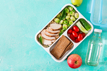 Foto op Canvas Assortiment Healthy green meal prep containers with chicken fillet, rice, brussels sprouts and vegetables overhead shot with copy space. Dinner in lunch box. Top view. Flat lay