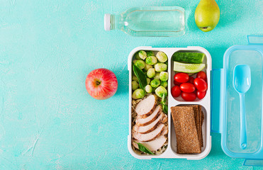 Foto auf Leinwand Sortiment Healthy green meal prep containers with chicken fillet, rice, brussels sprouts and vegetables overhead shot with copy space. Dinner in lunch box. Top view. Flat lay