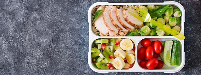 Foto op Canvas Assortiment Healthy green meal prep containers with chicken fillet, rice, brussels sprouts, vegetables and fruits overhead shot with copy space. Dinner in lunch box. Top view. Banner. Flat lay