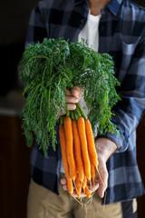 Gardener with carrots