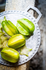 Juicy carambola on a plate