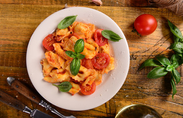 Traditional italian dish - tortellini with tomato sauce
