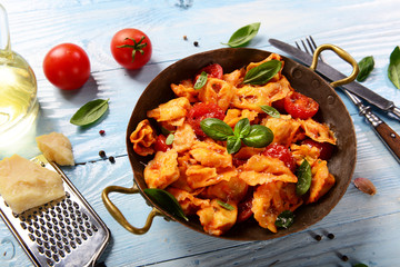 Traditional italian dish - tortellini with tomato sauce