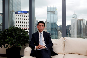 Hong Kong Commerce and Economic Development Secretary Edward Yau attends an interview in Hong Kong