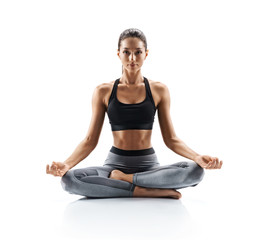 Poster Yoga school Sporty young woman doing yoga practice isolated on white background. Concept of healthy life and natural balance between body and mental development. Full length