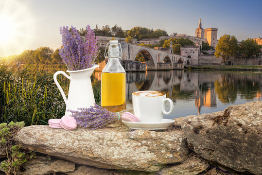 Lavender still life with cup of coffee against Avignon bridge in Provence, France