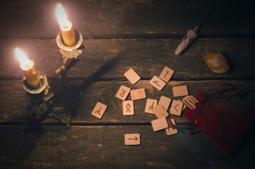 Magic divination runes on fortune teller desk table background. Futune reading concept.