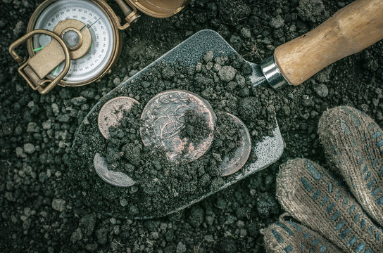 Russian empire ancient coins on the shovel and compass. Coins searching. Treasure hunting concept. In search of a lost treasure.