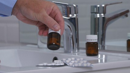 Man Taking a Medical Treatment in Bathroom Sort Pills and Drugs