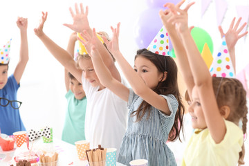 Cute little children celebrating Birthday at home