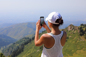 Woman use smart phone taking photo