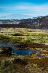 Steam Rises Off a Hot Spring in the Geysir Geothermal Field in Iceland
