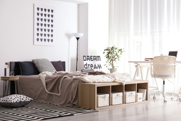 Interior of room with big comfortable bed