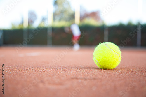 Tennis Ball On The Floor Of A Tennis Court In A Match In The Shade