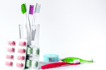 toothbrushes in glass on white background tools for oral care