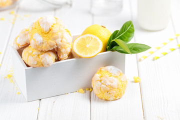 Cracked Lemon cookies on white wooden box, on white background