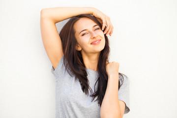 Happy brunette woman in gray t-shirt