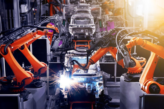 The factory floor of automobile production is producing cars