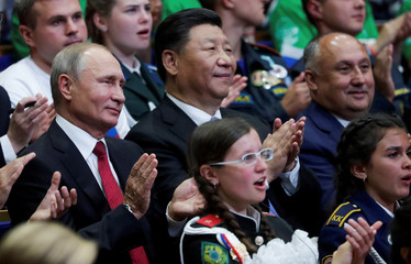 "Russian President Vladimir Putin and Chinese President Xi Jinping visit the ""Ocean"" All-Russian Children's Centre in Vladivostok"