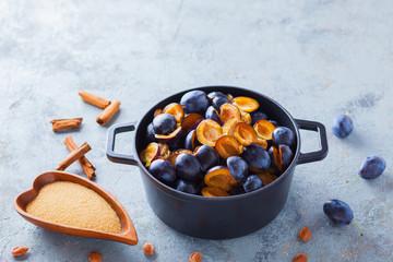 cast iron pot full of plums
