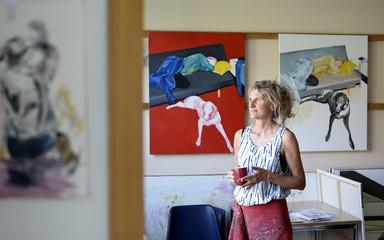 Female painter in her atelier, looking sideways
