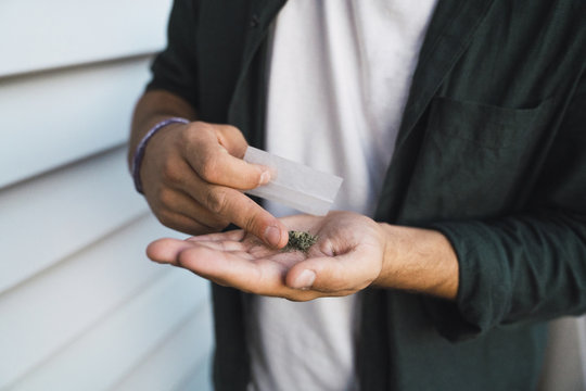 Young man with cannabis in hand