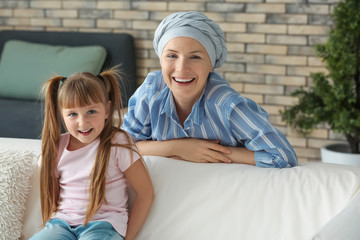 Little girl and her mother after chemotherapy at home