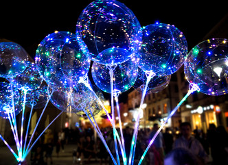 LUBLIN, POLAND - JULY 27, 2018: LED transparent balloon with multi-colored luminous garland.