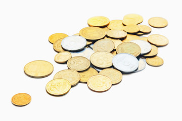 Scattered coins isolated