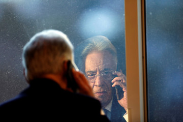 Brazil's former President Cardoso talks on the phone during an interview with Reuters in Sao Paulo