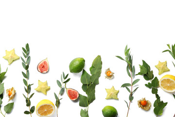 Summer composition with fresh tropical leaves and fruits on white background